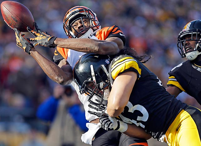 Steelers strong safety Troy Polamalu makes sure that Bengals receiver A.J. Green is not able to catch this pass.