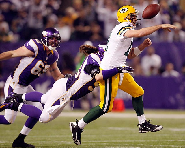 Defensive end Brian Robison hits Packers quarterback Aaron Rodgers, causing him to fumble the ball on during the second half of an NFL football game Sunday, Dec. 30, 2012, in Minneapolis. Minnesota's 37-34 win gave meant the Vikings will face the Packers again in the first round of the playoffs.