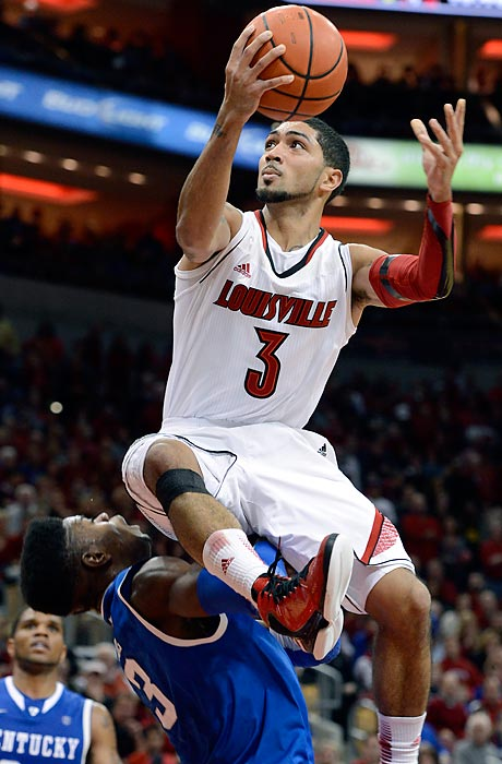 Louisville's Peyton Siva goes over Kentucky's Nerlins Noel for a layup, as Louisville defeated Kentucky, 80-77.