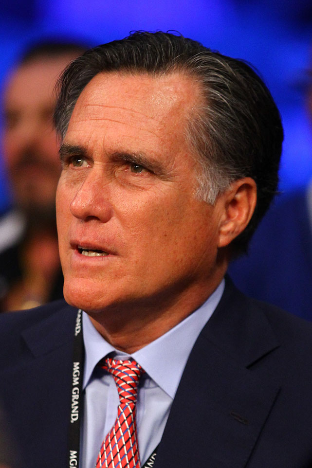 Former Republican presidential candidate Mitt Romney takes in Saturday's fights from ringside.