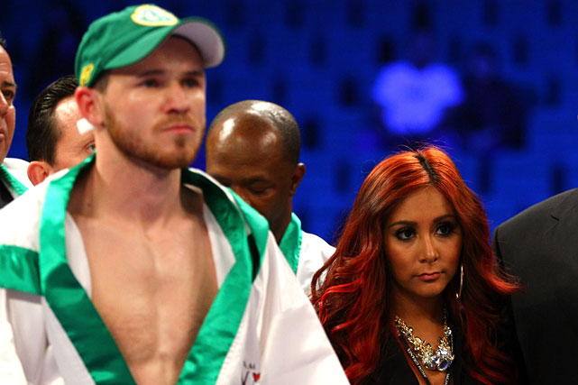 "TV personality Nicole ""Snooki"" Polizzi, who recently entered the boxing promotion business, stands with Patrick Hyland before Hyland's fight on the Pacquiao-Marquez undercard. (Her appearance  caused some confusion  on the Twittersphere.)"