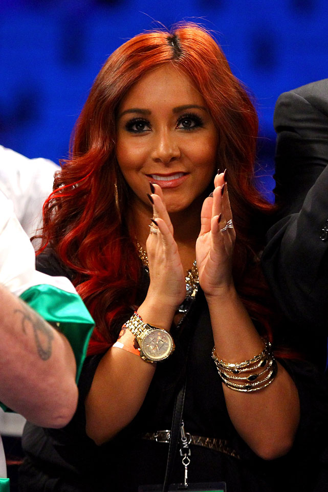 Snooki applauds while in the ring before Hyland's fight. Hyland lost a unanimous decision to Javier Fortuna in a 12-round bout for the WBA interim featherweight title.