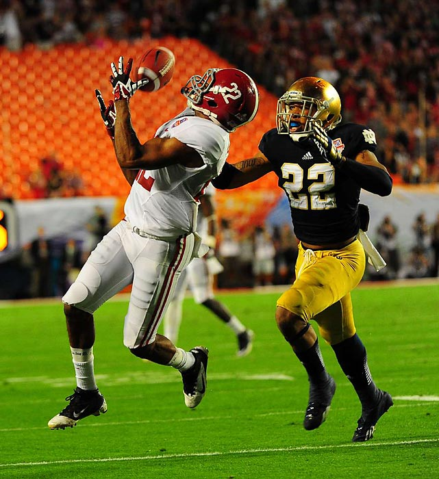 'Bama wide receiver Christion Jones hauled in a pass as he gained separation from Notre Dame safety Elijah Shumate. Jones was one of eight 'Bama receivers to catch a pass in the BCS National Championship Game.