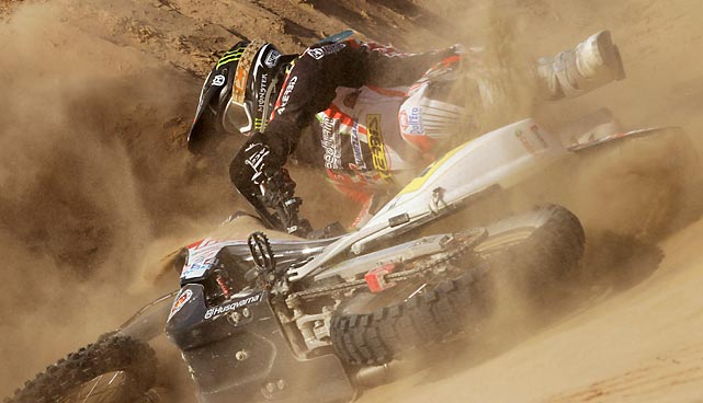 Husqvarna rider Alessandro Botturi of Italy falls from his motorcycle during the third stage of the 2013 Dakar Rally. The race runs down the western coast of South America from Lima, Peru, to Santiago, Chile.