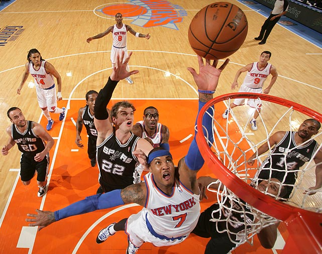 New York Knicks small forward Carmelo Anthony drives to the hoop as San Antonio Spurs power forward Tiago Splitter trails. The Knicks handed the Spurs just their ninth loss of the season with a 100-83 victory at Madison Square Garden on Jan. 3.