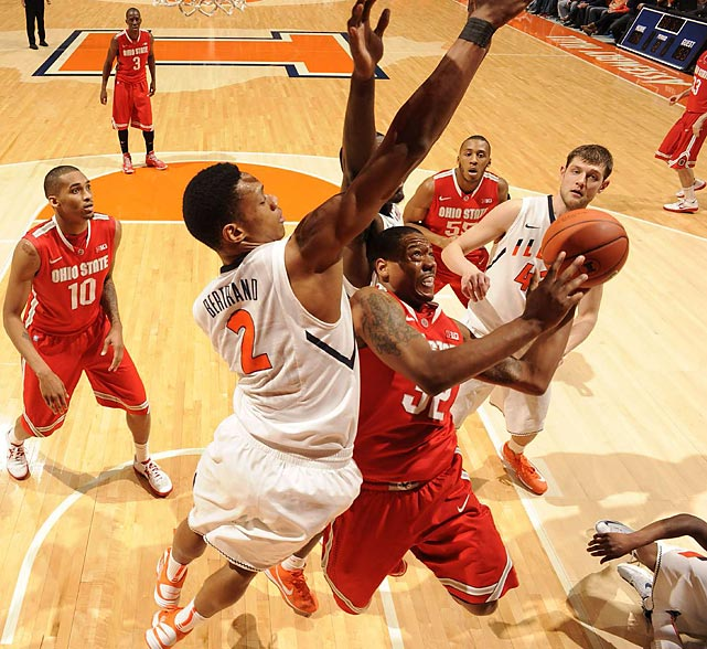 Illinois guard Joseph Bertrand disrupts the shot of Ohio State guard Lenzelle Smith Jr. in the Fighting Illini and Buckeyes' Jan. 5 matchup. Illinois easily got the best of the Buckeyes, 74-55.