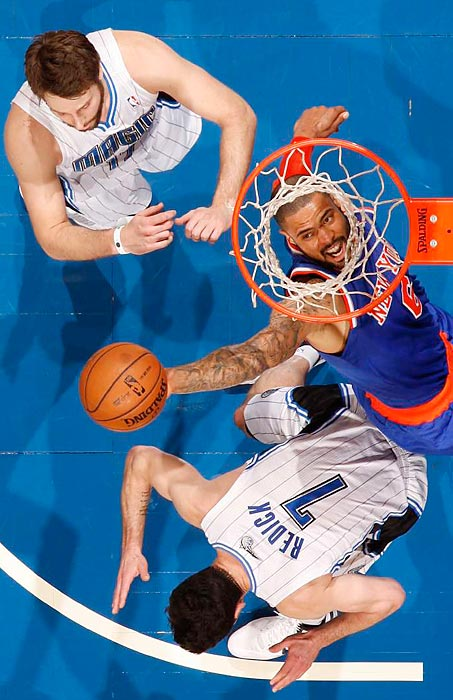 New York Knicks center Tyson Chandler rises up for a slam over  the Orlando Magic's J.J. Redick during New York's 114-106 win on Jan. 5.