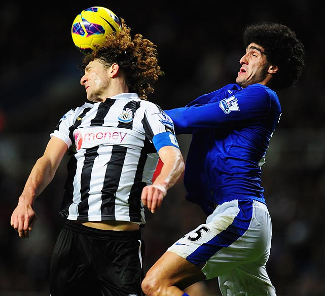 Newcastle defender Fabricio Coloccini challenges Everton midfielder Marouane Fellaini for a header during the two clubs' Barclays Premier League match on Jan. 2. Everton prevailed 2-1 at St. James' Park in Newcastle upon Tyne, England.
