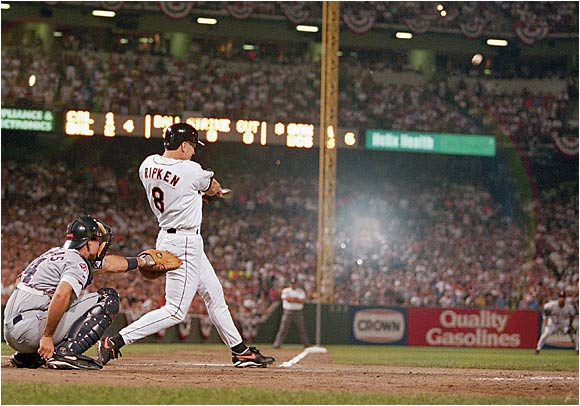 On the night in which he broke Lou Gehrig's record for most consecutive games played, Cal Ripken Jr. added an exclamation point by hitting a home run in the fourth. The Orioles went on to a 4-2 victory.