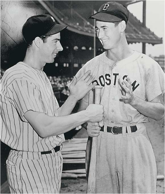 Joe DiMaggio, left, was on base when Ted Williams hit a two-out, three-run homer in the bottom of the ninth to lift the AL to a 7-5 victory in the Midsummer Classic in Detroit's old Briggs Stadium.