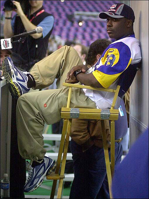 "For Rams RB Marshall Faulk: ""How come you have a podium while all your teammates are forced to stand out here?"""