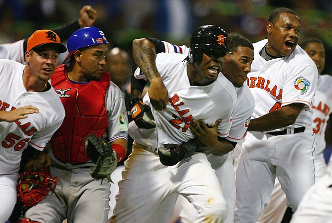 Eugene Kingsale (center) scored the winning run in the 11th inning, giving the Netherlands an upset win in the World Baseball Classic over the heavily favored Dominican Republic. The Dominicans featured professional players David Ortiz, Hanley Ramirez, Miguel Tejada and Pedro Martinez, but lost twice to the Netherlands in the opening round of the tournament.