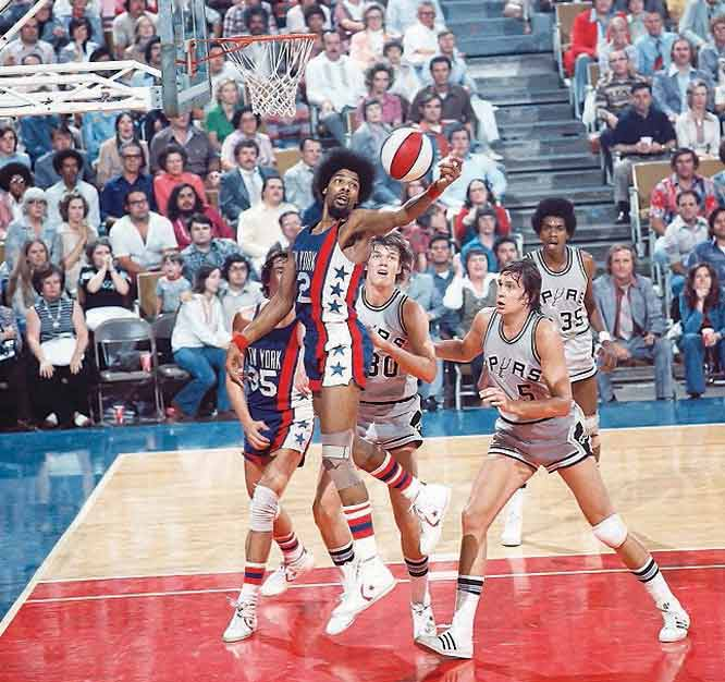 The ABA agrees to merge four of its teams -- the New York Nets, Denver Rockets, Indiana Pacers and San Antonio Spurs -- into the NBA.