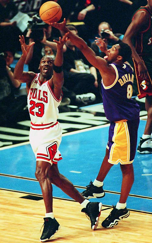 """In only his second season, Bryant became the darling of Madison Ave., as newspaper ads promoting the 1998 All-Star Game portrayed a face-off between Bryant and a soon-to-retire Michael Jordan. Bryant did his part to play into the hype, scoring 18 points in 22 minutes through three quarters, and at one point waving off a screen from Karl Malone so he could challenge Jordan directly. But West coach George Karl ended the showdown, sitting Bryant in the final quarter as Jordan walked away with the game's MVP trophy. Karl intimated that Bryant was benched because of grumbling from veterans such as Malone, who said, """"I told Coach Karl, 'Hey, when younger guys are telling me, Get out of the way, that's a game I don't need to be in.'"""""""