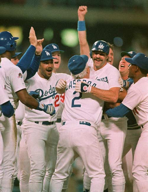 With two outs in bottom of ninth, an injured Kirk Gibson hits a dramatic two-run home run to give the Dodgers a 5-4 win in the first game of the World Series.