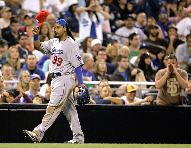 With half the crowd at sold-out Petco Park wearing Dodger blue and cheering him on, Manny Ramirez went 0-for-3 with a walk in his return from a 50-game suspension.