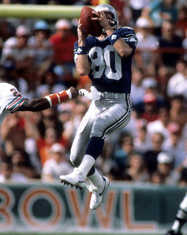 Seattle wide receiver Steve Largent makes his NFL record 100th touchdown catch in the Seahawks' 24-17 win at Cincinnati.