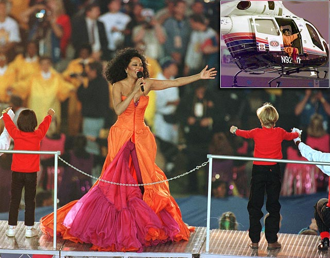 "Diana Ross sang a few lines from a dozen of her classic hits while making four costume changes. For her exit, she hopped into a helicopter, swung her legs out the side and flew off into the sunset -- to the strains of ""Take Me Higher."" Now that's a diva!"
