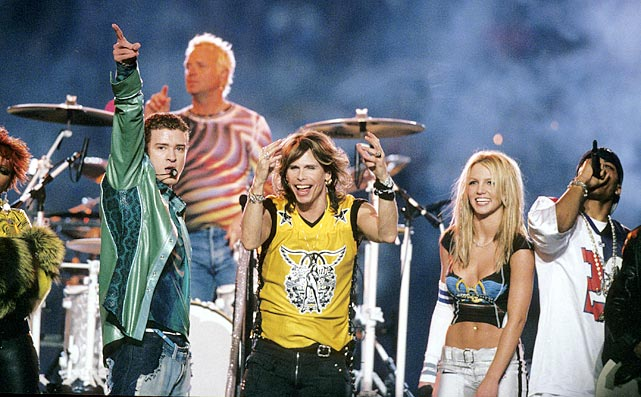 "The worlds of rock, pop and hip-hop collided in an MTV-produced extravaganza. N'Sync and Aerosmith headlined the show, which included spectacular fireworks and constant strobe lights. The collaborative closing number (""Walk This Way"") was memorable, as was Britney's ridiculous Barbarella-meets-Mrs.-Jetson outfit."