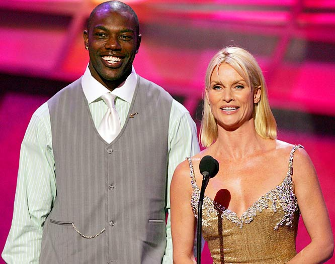 """On Nov. 15, 2004, before a Monday-night contest, Owens appeared in a controversial skit with """"Desperate Housewives"""" Nicolette Sheridan that later created a national media firestorm. Here are Owens and Sheridan at the ESPYs."""