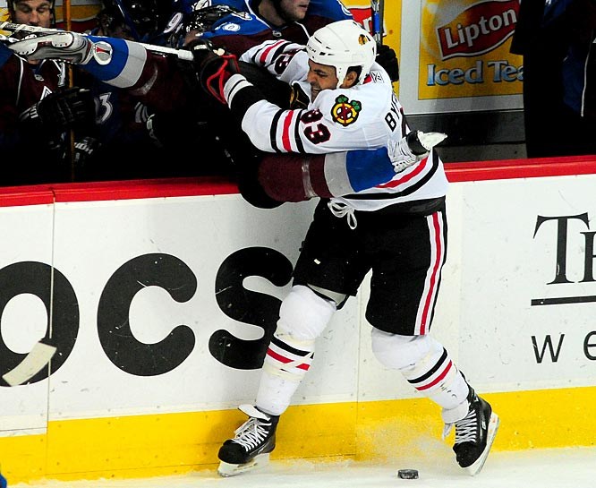 """The Blackhawks' bowling ball winger throws his weight (250 pounds) around with feisty physicality, and ranks second in the playoffs this season with 55 hits after two rounds. In Game 2 of the west semifinal vs. Vancouver, Byfuglien (pronounced Buff-lin) bowled over goalie Roberto Luongo, changing the course of the contest and the series, which Chicago won in six. """"The team just needed someone to be a physical force all the time,"""" he told the Vancouver Sun. """"I figured I might as well try it and see what happens."""""""