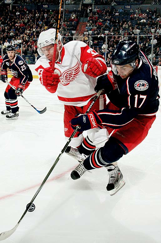 """A veteran of 18 seasons and four Cups, Detroit's checking center and member of its famed """"Grind Line"""" is only 5-9 and 190 pounds, but still plays with relentless abandon. A skilled penalty-killer and face-off man, Draper, 37, was sidelined by an upper body injury through most of this year's first two rounds but badgered the Red Wings into letting him play in their Game 7 win over the Ducks, in which he was plus-one."""
