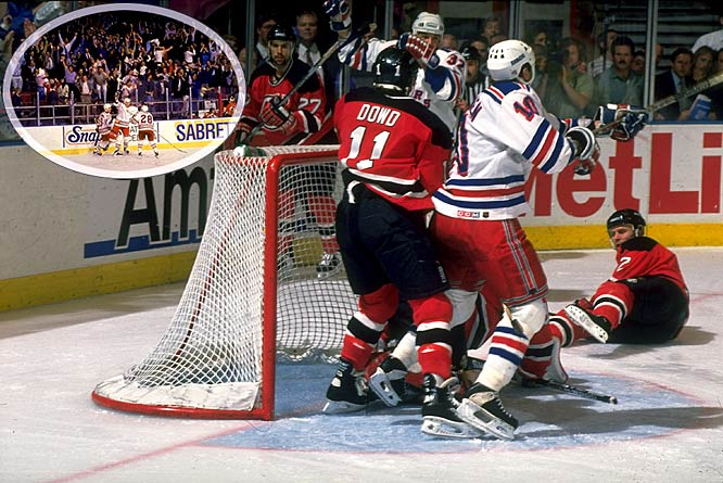 """Mark Messier's famous guarantee of a Rangers victory in Game 6 set up this nail-biting defensive battle. New York led 1-0 until the Devils tied the game with only 7.7 seconds left in regulation at Madison Square Garden. The winner was scored on Devils goalie Martin Brodeur by Stephane Matteau (32) at 4:21 of the second extra session -- his second double-OT goal of the series. Rangers fans will never forget broadcaster Howie Rose's cries of """"Matteau! Matteau!"""""""