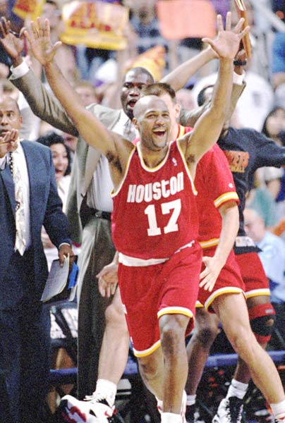 Houston's Mario Elie converts a three-pointer from the corner with 7.1 seconds left in the game, lifting the visiting Rockets to a 115-114 win over Phoenix in Game 7 of their Western Conference Semifinal Round series at America West Arena.