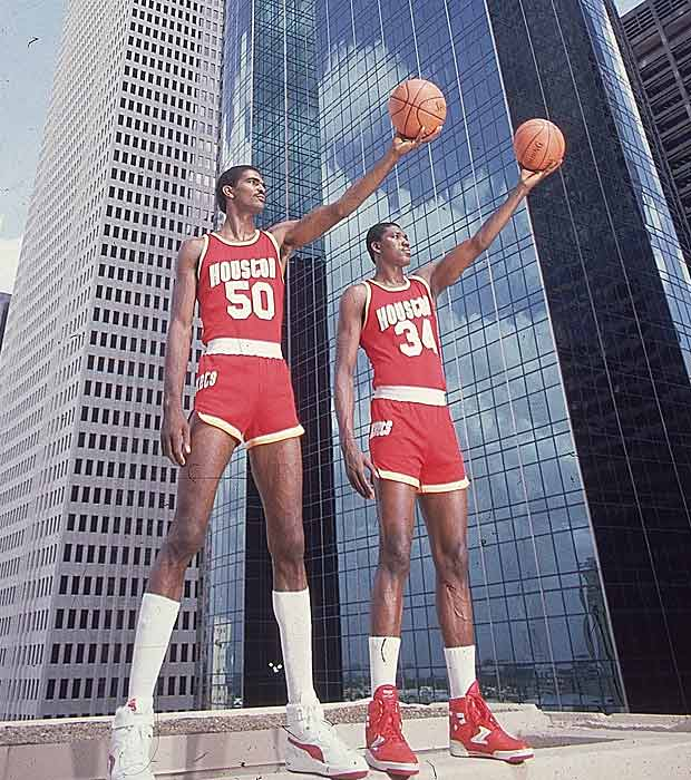 Ralph Sampson (left) and Hakeem Olajuwon defeat the Los Angeles Lakers, 114-112, at Los Angeles in Game 5 of the 1986 Western Conference Finals. The loss kept the defending champion Lakers, who had won 62 games during the regular season, out of the NBA Finals for the only time in a span of eight years from 1982 through 1989.