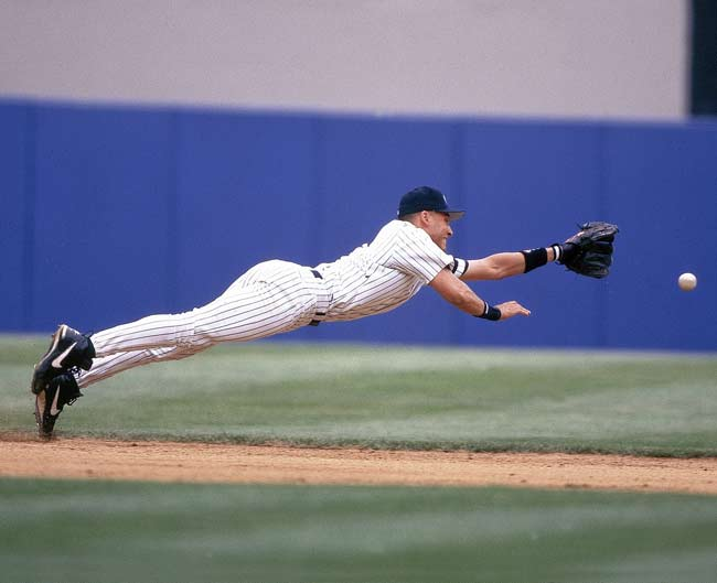 Rookie Derek Jeter dives for a groundball during a game against Baltimore.