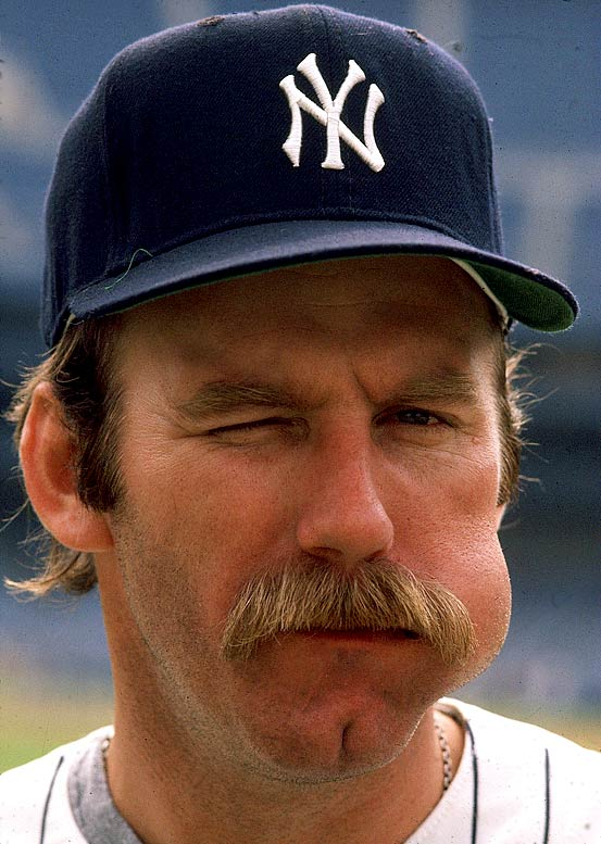 Sparky Lyle enjoys a chew prior to a game against the Red Sox.