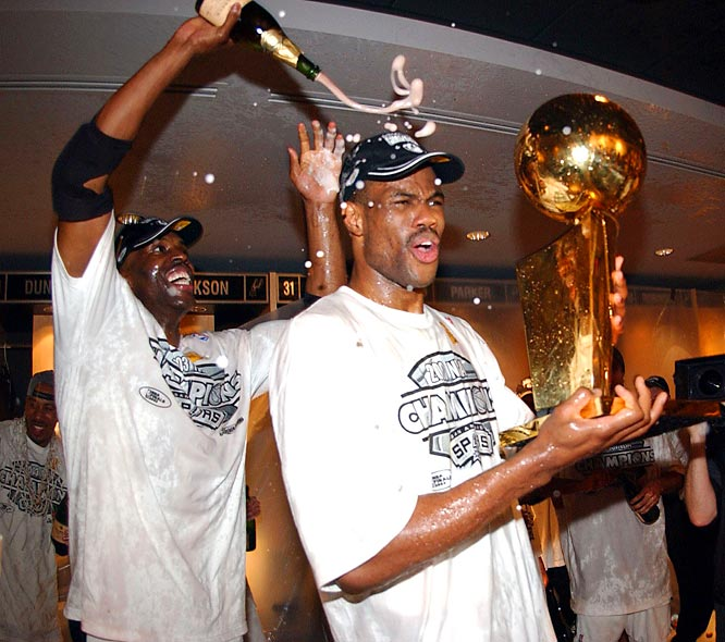 David Robinson gets a champagne bath courtesy of Kevin Willis after the Spurs won the 2003 NBA Championship.