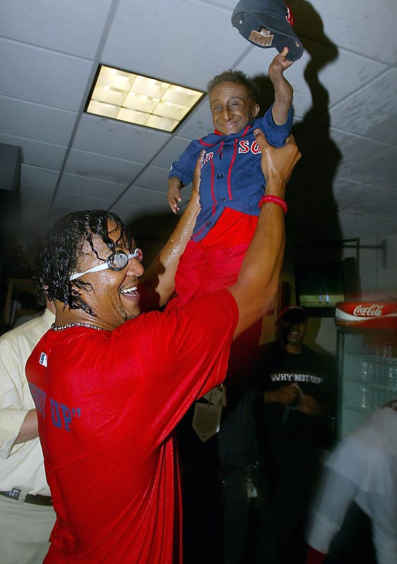 Pedro Martinez holds his friend and good luck charm Nelson De La Rosa during a celebration of the team's win over Anaheim in the American League Division Series.