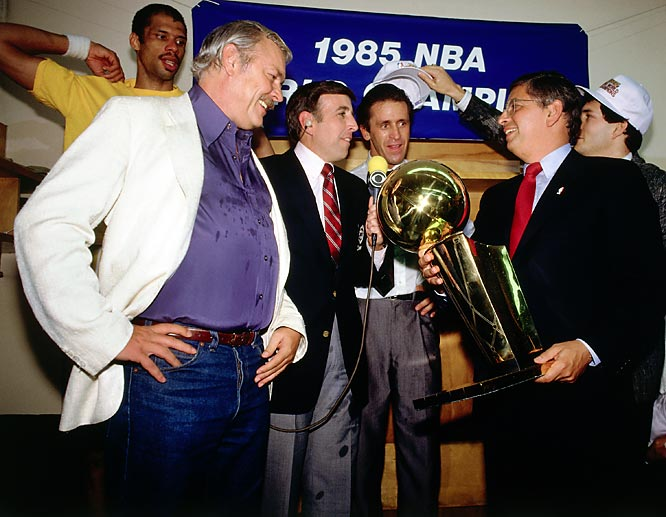 NBA Commissioner David Stern presents the championship trophy to Lakers owner Jerry Buss while Pat Riley and Kareem Abdul Jabbar look on after Los Angeles won the 1985 NBA Championship.