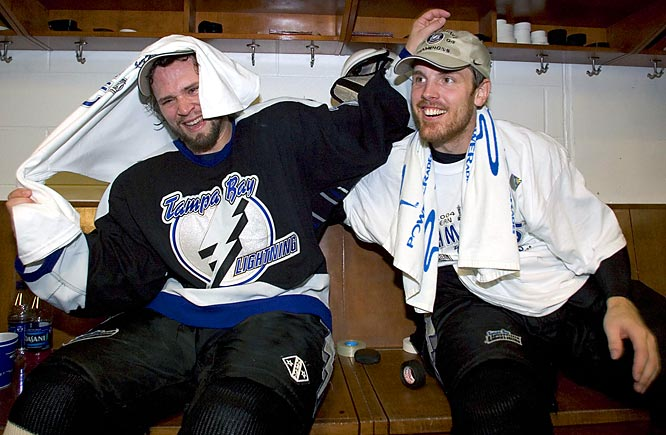 Tampa Bay Lightning players Martin St. Louis (left) and Brad Richards celebrate in the locker room after defeating the Philadelphia Flyers, 2-1, to win the NHL's Eastern Conference.
