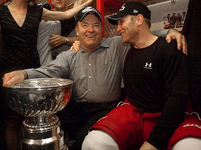Detroit head coach Scotty Bowman celebrates with Brett Hull and the Stanley Cup in the locker room after the Red Wings beat Carolina, 3-1, to capture the championship.