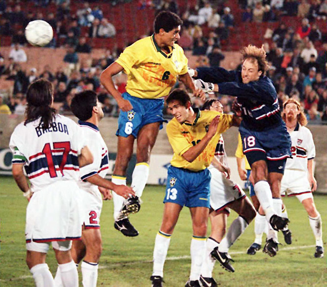 Brazil was an invited guest to the North and Central American championship, and was an enormous favorite over the hosts in the semifinals. But the Seleção didn't bargain on Kasey Keller (18) having the game of his life. The emerging star keeper made 10 superb saves on a Romário-led attack as the U.S. held on for a 1-0 victory, its first in nine games over the four-time World Cup champs.