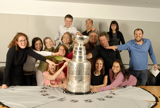 Staff members of Sports Illustrated pose with the Cup during its visit to the magazine's New York offices.