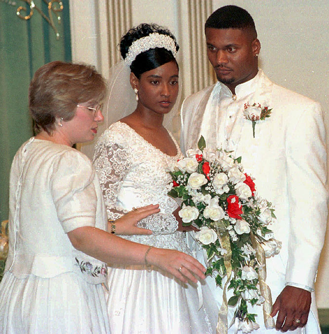 On June 21, 1997, Steve McNair and bride Mechelle Cartwright take directions during a photo session after their wedding at Bowmar Avenue Baptist Church in Vicksburg, Miss.