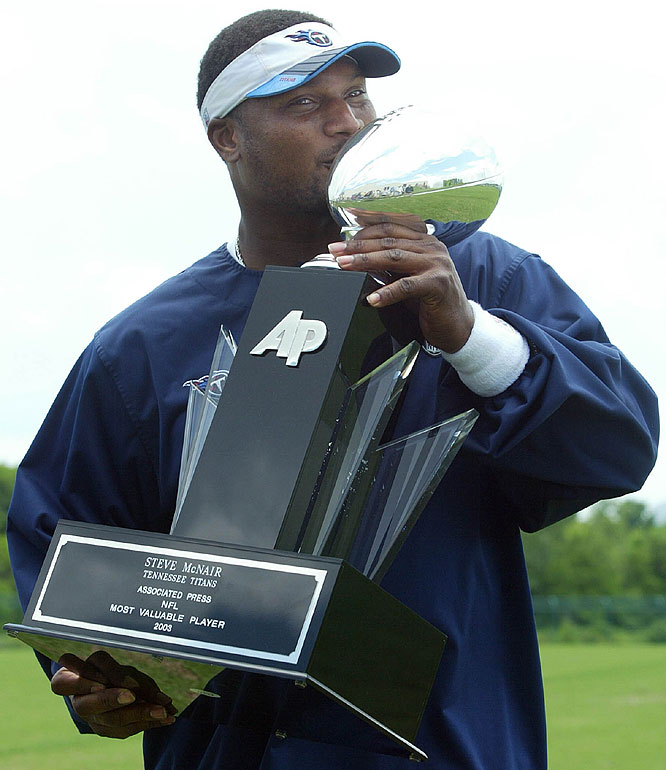 "On May 18, 2004, Steve McNair said ""I feel like Tiger Woods"" as he kisses the Associated Press NFL Most Valuable Player trophy."
