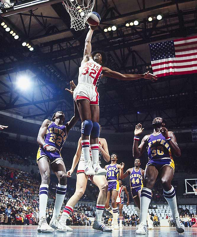 "If you weren't following pro hoops at the time, you simply can't imagine the excitement generated when Dr. J, the ABA legend, moved from the New York Nets to the NBA's Philadelphia 76ers before the 1976-77 season. Remember that games were rarely televised back then, so most of America had only heard tales of the graceful 6-7 forward with the big hands and the gravity-defying artistry. When folks first saw Dr. J, their eyes popped: It seemed as if he could temporarily suspend himself in air while coasting from one side of the basket to the other. And thus was born the concept of ""hang time."""