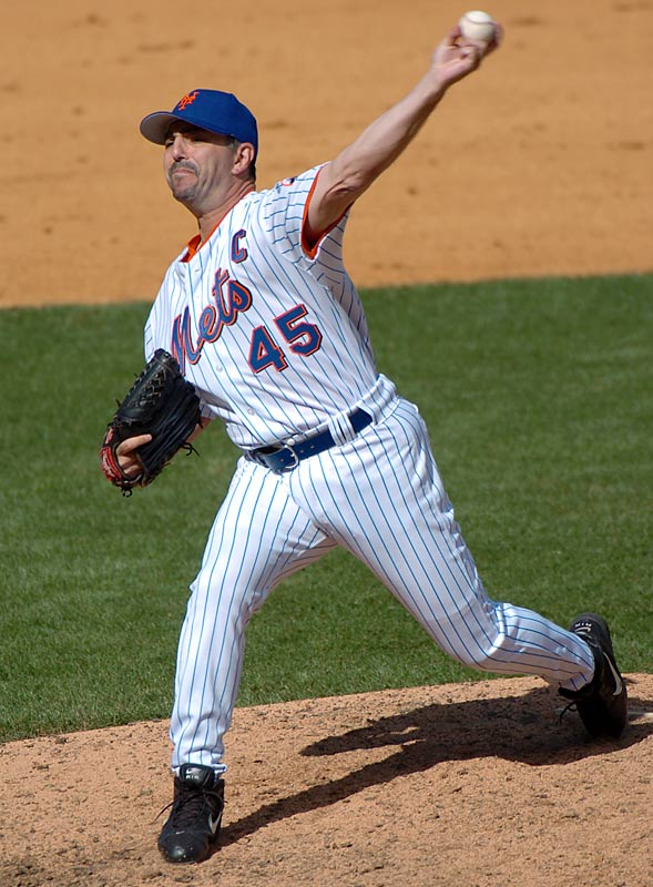 john franco unleashes a pitch during a game against Florida. Franco's 1,119 career games is an NL record and third most in major league history.