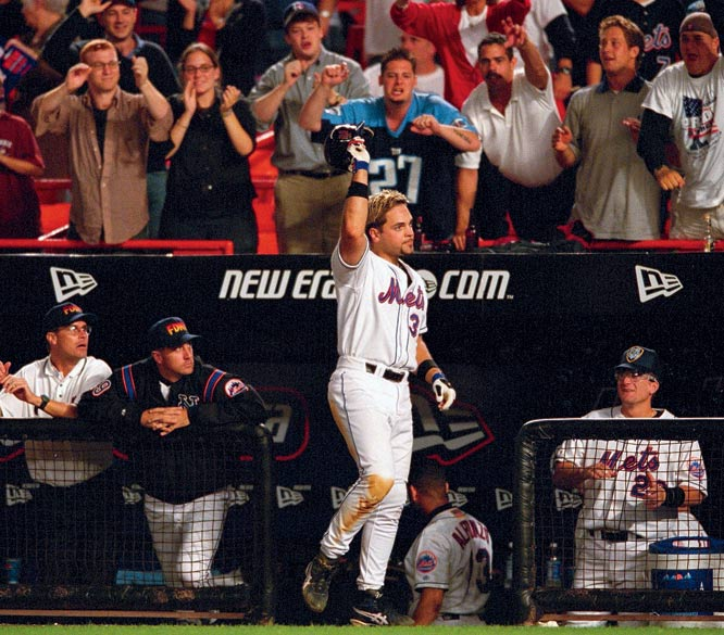 Mike Piazza tips his hat to the crowd after hitting a two run homerun to win the game against Atlanta. The game was the first played in New York City after the terrorist attacks of September 11 and is considered one of the greatest moments in Major League Baseball history.