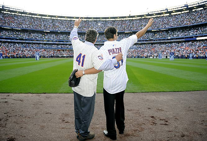 Mets legends Tom Seaver and Mike Piazza wave goodbye to the crowd after final game at Shea Stadium.