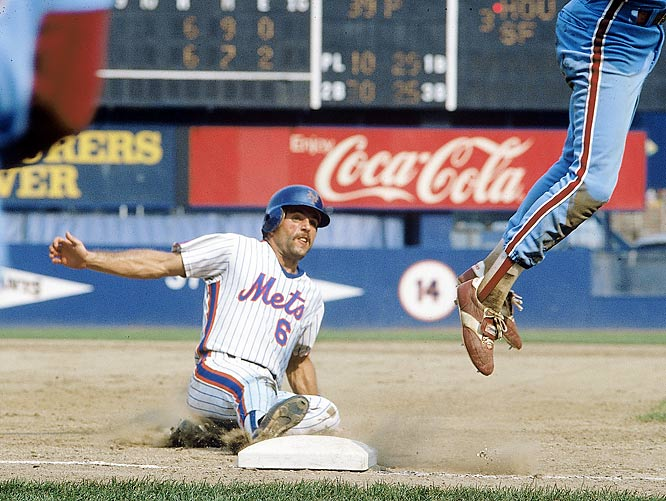Wally Backman slides into third during a game against the  Phillies. Backman spent nine seasons with the Mets and was a key member of the team's 1986 World Series victory.