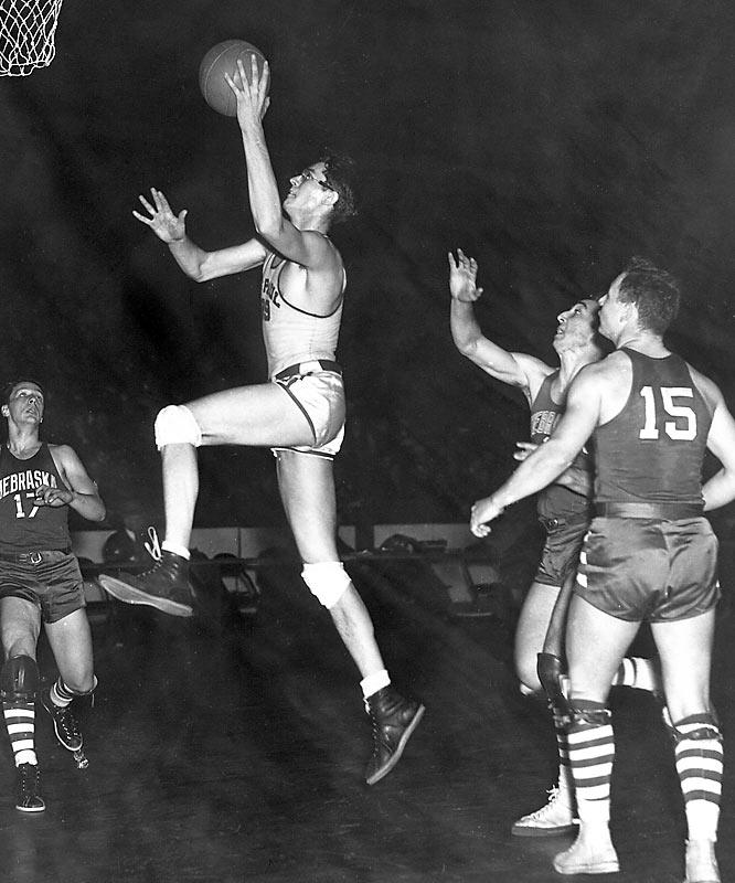 """Mikan was the league's first dominant big man. He helped kick-start the Lakers' franchise, then in Minneapolis, with its first four league titles, including three in a row from 1952-54. Little wonder the Lakers' visits to New York at the time were billed as """"George Mikan vs. Knicks"""" on the marquee at Madison Square Garden."""