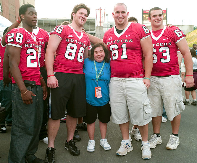 Cynthia Saunders poses with members of the Rutgers football team during the 2008 New Jersey Special Olympics.