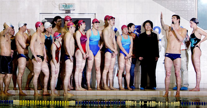 U.S. swimmer Michael Phelps instructs students at a swimming clinic during a goodwill trip to Beijing to promote the 2007 Special Olympics World Summer Games.