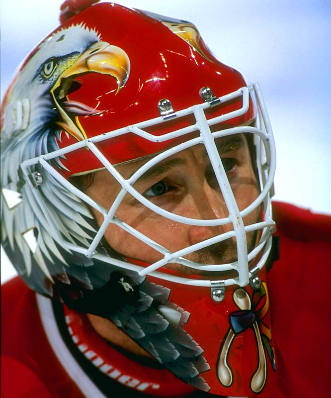 """A fiery competitor, Belfour was known by two nicknames during his years with the Blackhawks (1988-97): """"The Eagle"""" -- after the bird on his mask (Belfour admired eagles for their majesty and aggression) -- and """"Crazy Eddie"""" for his volatile unpredictability. The Eagle led the Hawks to the Stanley Cup Final in 1992, and later won the chalice in 1999 with the Dallas Stars."""
