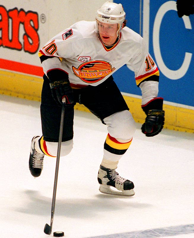 One of the fastest skaters of the 1990s, Bure landed with the Vancouver Canucks in the sixth round of the 1989 NHL Draft, after a stint with the Soviet Red Army Team. The Russian Rocket scored 50 or more goals -- including 60 twice -- five times in his 12 NHL seasons before he was finally brought down by major knee injuries.